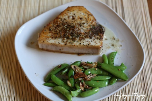 Pan-Roasted Swordfish Steaks with Mixed-Peppercorn Butter with Garlicky Snap Peas